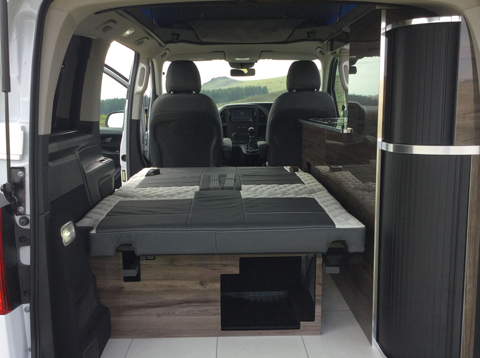Konigsmann Camper Van Multiple storage areas with sliding tambour doors